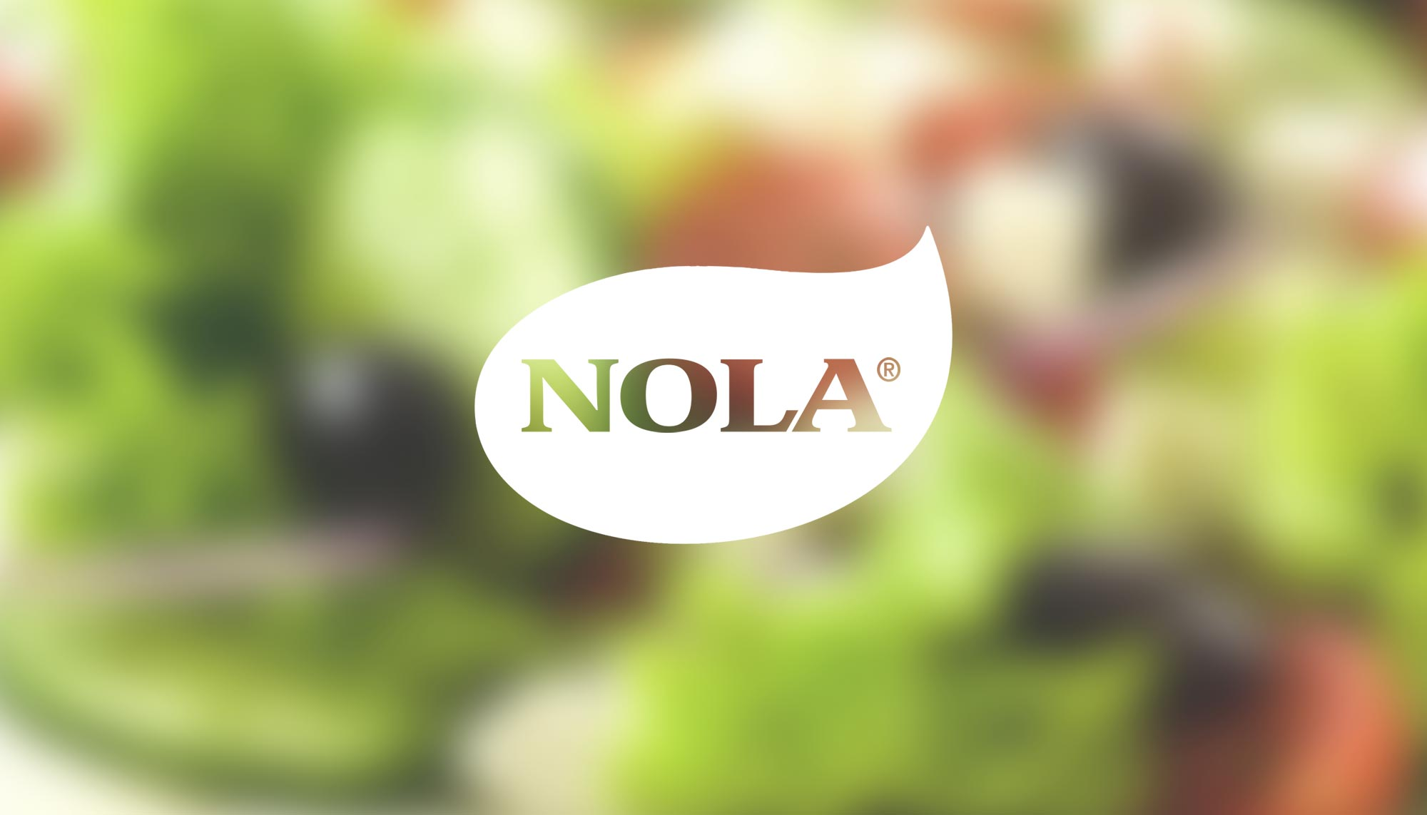 White Nola Logo on blurry salad background